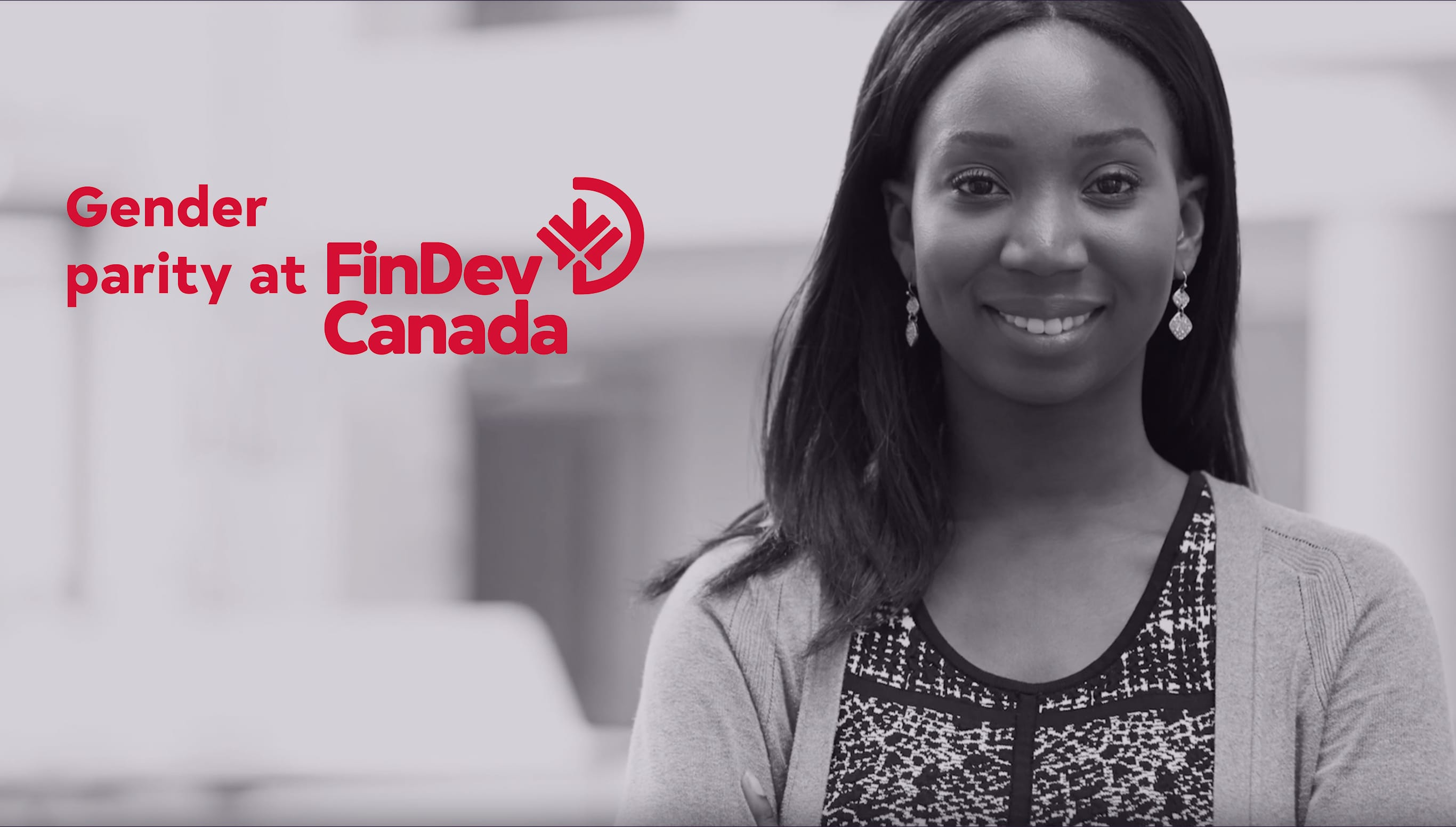Young FinDev employee smiles in the workplace